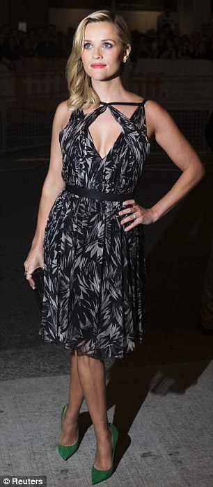 Fin and flirty: The actress looked perfectly polished in a black and grey silk chiffon dress that featured a leaf pattern and an unusual neckline, which was a combination of a V-neck with straps that crossed over the star