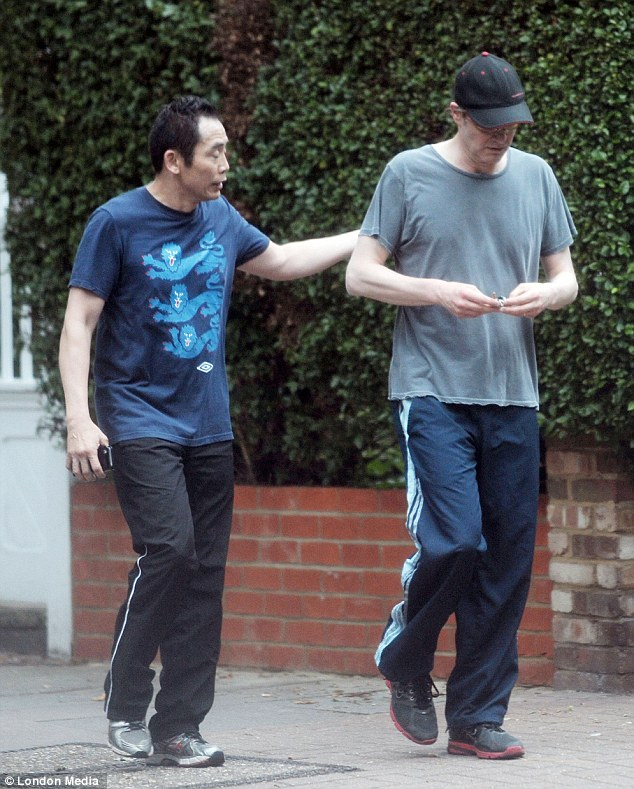 The road to Oscar glory again? Colin seen with his trainer earlier this year