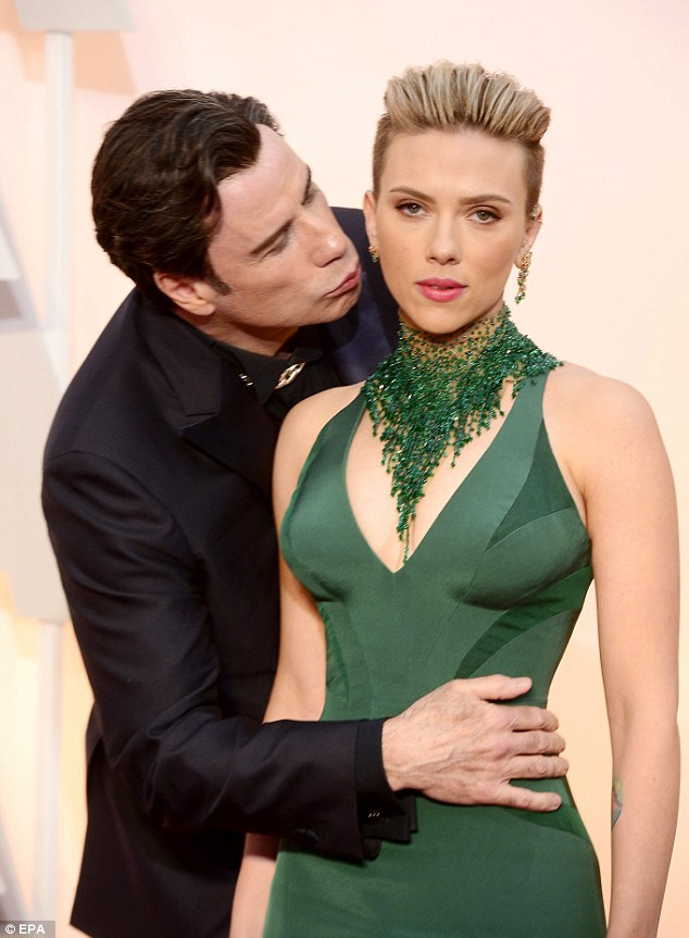 Nothing to see here: Scarlett Johansson has debunked the already infamous picture of her getting kissed by John Travolta at last Sunday