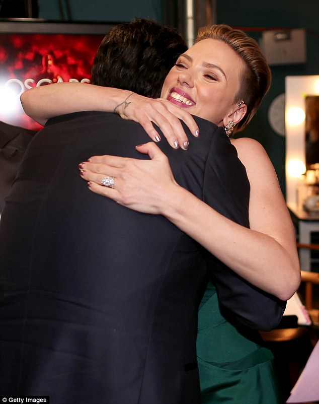 Backstage: In a far less publicized shot, Scarlett can be seen happily embracing the actor