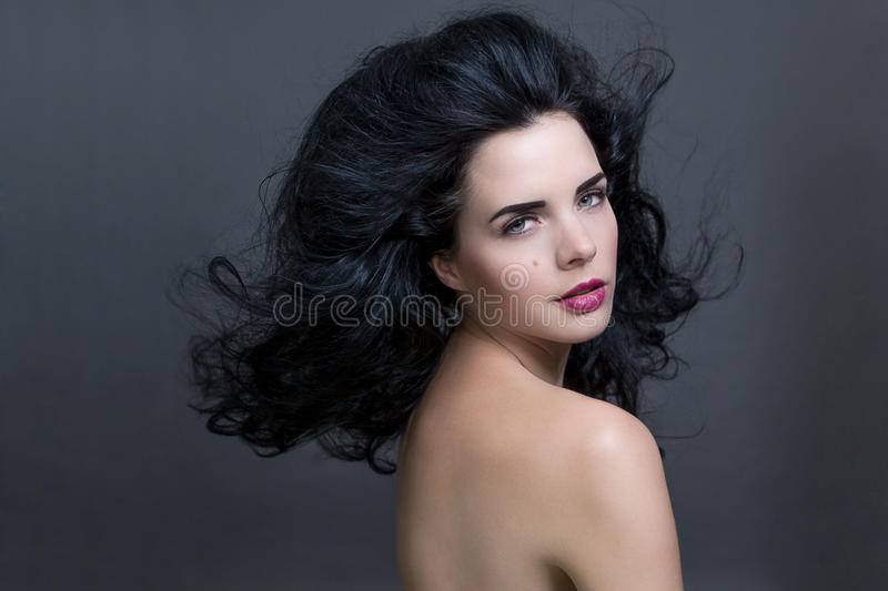 Beautiful woman with a gentle serene expression royalty free stock image