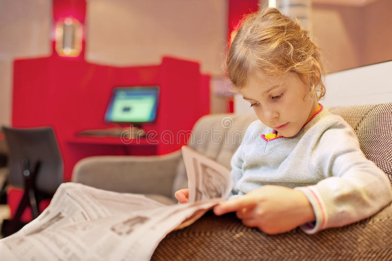 girl sitting and read newspaper royalty free stock images