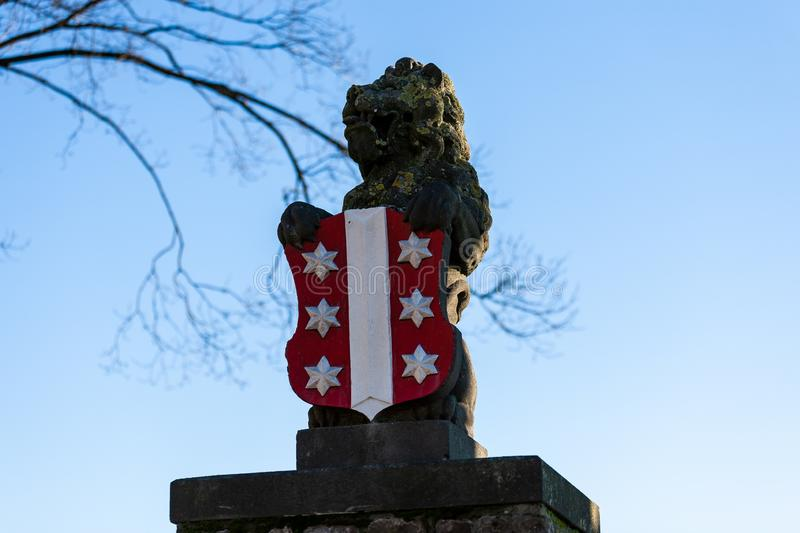 Gouda, South Holland/the Netherlands - January 20 2019: portrait shot of the lion statue with Gouda city logo on the shield stock photo