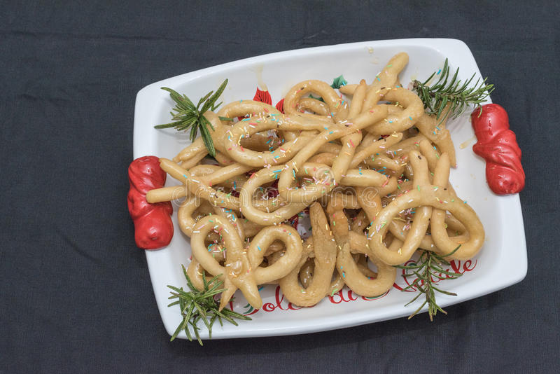 Scavuratielli, Christmas sweets of italian tradition. Cilento food. Fried donuts covered in honey stock image