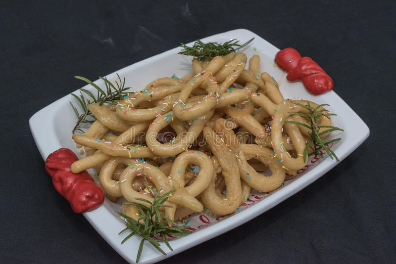 Scavuratielli, Christmas sweets of italian tradition. Cilento food. Fried donuts covered in honey stock photography