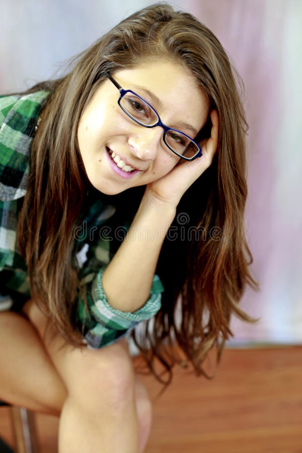 Teen wearing glasses stock image