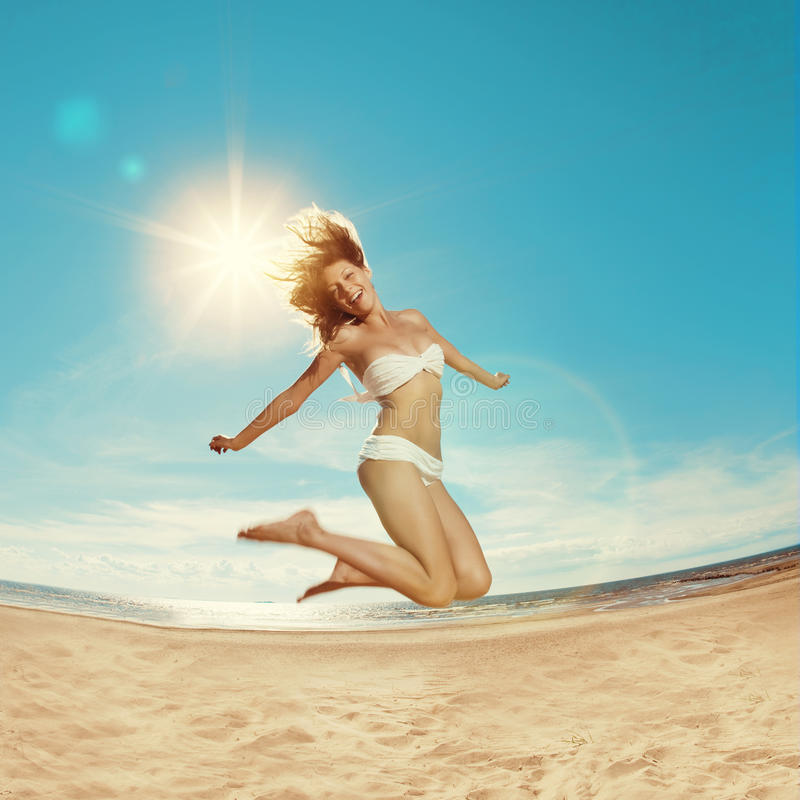 Woman on the beach. Young girl on the sand by sea. Stylish beaut stock image