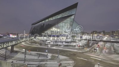 Minneapolis, MN - December 2017 - a wide angle long exposure shot of the new US Bank Stadium and Lightrail Train and Car Traffic D stock video footage